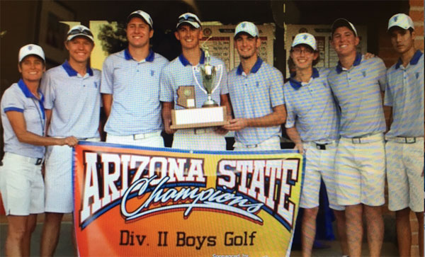 Foothills Boys golf team holding state championship banner.