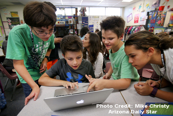 Students using laptop computer. Photo Credit: Mike Christy, Arizona Daily Star